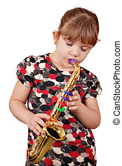 little girl play music on saxophone