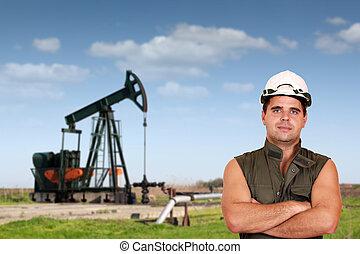 oil worker posing on oil field