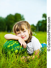 girl with watermelon - cute little girl with a watermelon on...