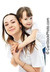 mother and daughter having fun - beautiful young mother...