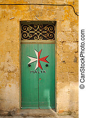 Maltese door - Maltese Cross painted on a old green doorway,...