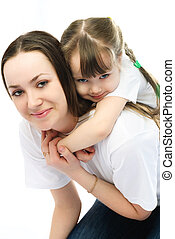 mother and daughter having fun - beautiful young mother and...