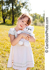 girl in the park - cute happy little girl with a toy in the...