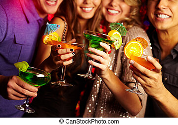 Cocktail party - Young people having fun at a party with...