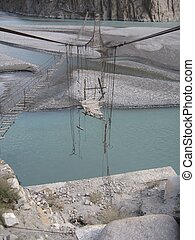 Hussaini Village in Pakistan - Broken rope bridge in...