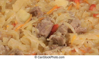 Bigos. - Dish of stewed meat and sauerkraut with spices.