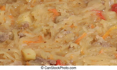 Bigos. - Dish of stewed meat and cabbage with spices.