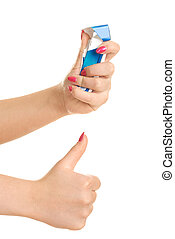 woman rumpling a pack of cigarettes - closeup of the hands...