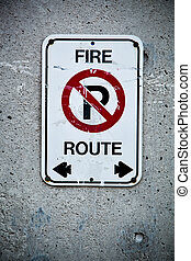Fire Route Sign - Fire route sign on a concrete wall