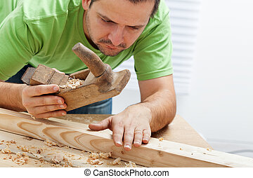 Man working with wood and traditional tools