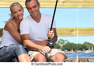 Couple fishing in the sun