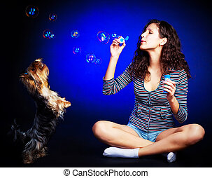 pretty girl with soap bubbles - pretty young brunette woman...