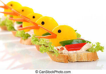 Funny duck morsels - Baguette with cream cheese and bell...