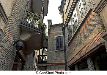 Narrow alley of Shanghai xintiandi - Behind the old brick...