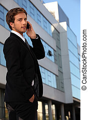 Young executive using a cellphone