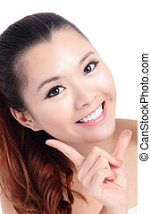 Fresh smiling woman face close up with hand isolated on...