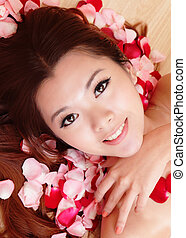 beauty Girl smiling close-up with rose background