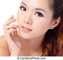 beauty skin care woman smile and touching her face - Asian...