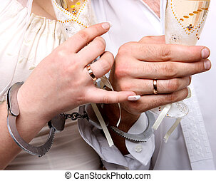 Wedding. Hands in handcuffs newlyweds