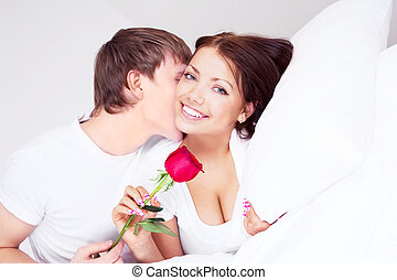 happy couple - young man kissing his beautiful girlfriend...