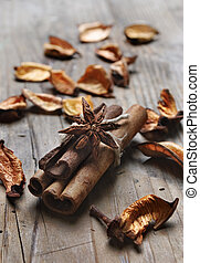 Cinnamon and anise seed on wooden plank