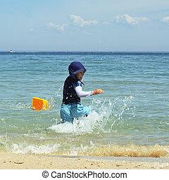 Boy splashing water