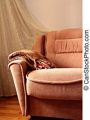 interior of the sofa with a blanket