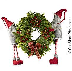 Christmas wreath carried by elves - Fresh Christmas wreath...