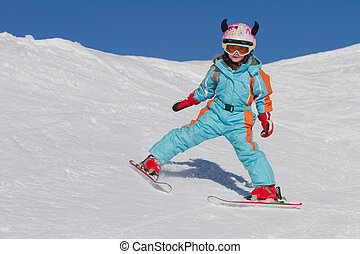 Little girl skiing downhill - Young female skier on a ski...