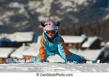 Little girl skier on her knees - Little girl getting up...