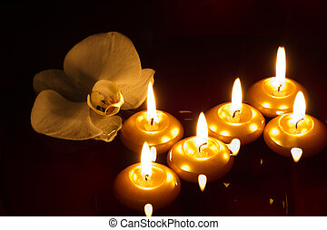 Floating candles and orchid in dark - Floating candles and...