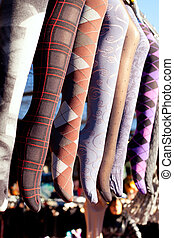 colorful tights in a row hanging in market