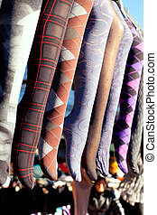 colorful tights in a row hanging in market - colorful tights...