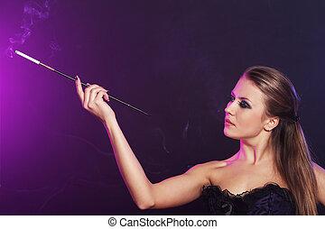 Beautiful woman smoking cigarette - Portrait of Beautiful...