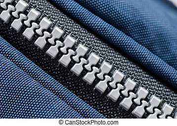 zip - close up view of plastic zip on blue color bag.