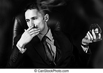 man with Old Brandy Glass, smoking cigar - Black and white...