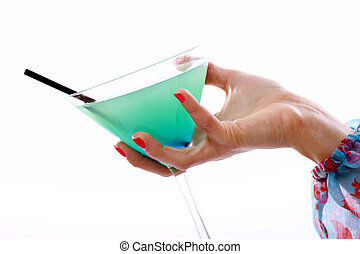 Hand with glass of cocktail over white background