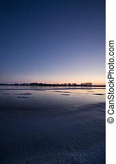 Sunset on Frozen Lake