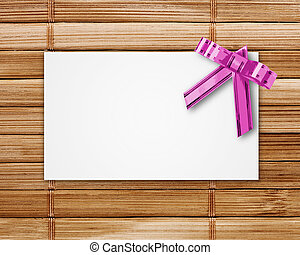 blank postcard tied with a bow