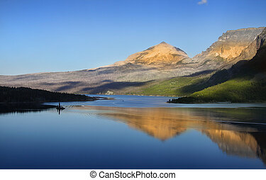 Reflection of hills in Saint Mary lake