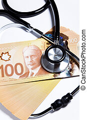 Stethoscope and Canadian dollar, concept of Financial Health