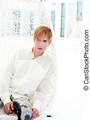 blond modern man portrait in summer terrace vampire...