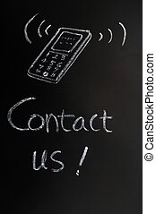 Contact us - text written in chalk on a blackboard