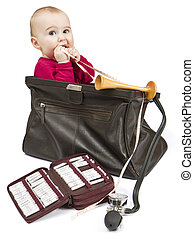 young child sitting in midwifes case with homeopathic...