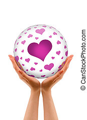 Hands holding a Love Sphere