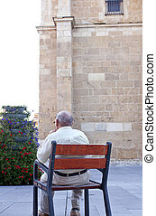Old man sitting on the bench, Leon