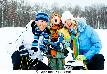 family ice skating - happy young parents going ice skating...