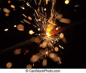 Celebratory sparks - Burning Bengal fire on a black...