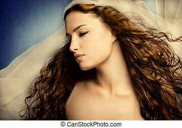 bride - young woman with veil, long curly hair, eyes closed,...