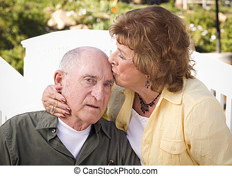 Senior Couple Kissing in the Park